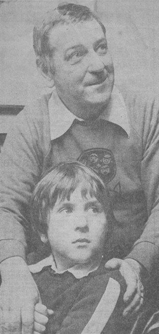 Julian Martin, aged 9, with his father, Bill Martin